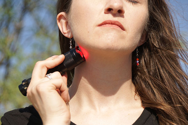Photopuncture Torch On Neck